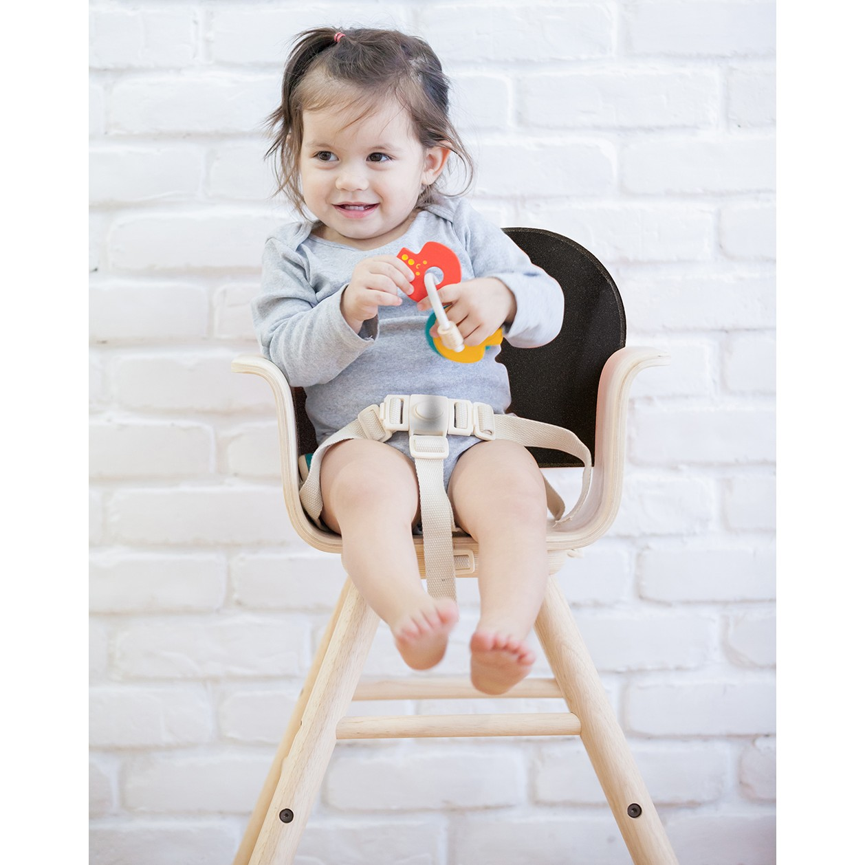 Black child sitting in chair - Plan Toys Black High Chair